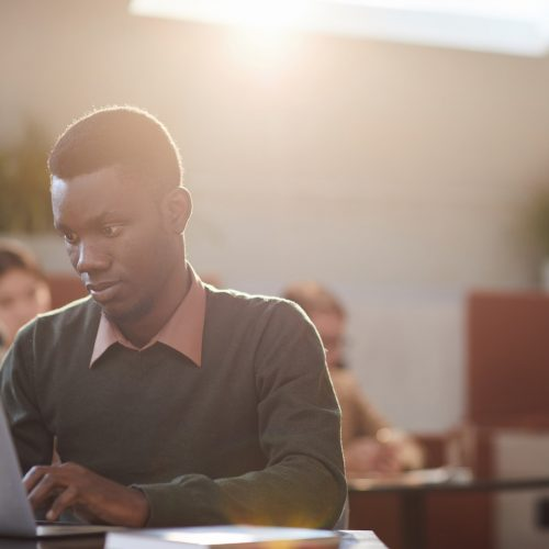 African Man Working in Cafe